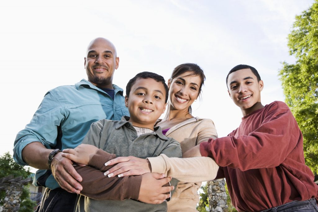 Portrait of Hispanic family outdoors